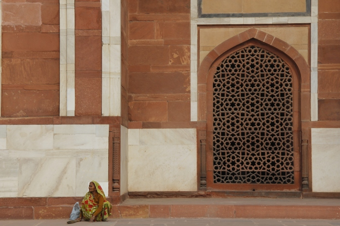 Humayun's Tomb, Delhi - Colourful lady sweeping the tomb.